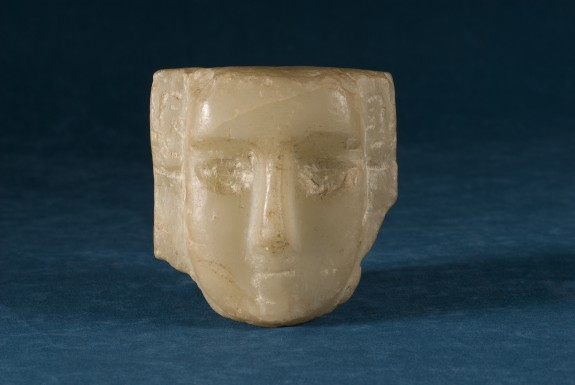 Fragment of a Small Head-Stela with a U-Shaped Face