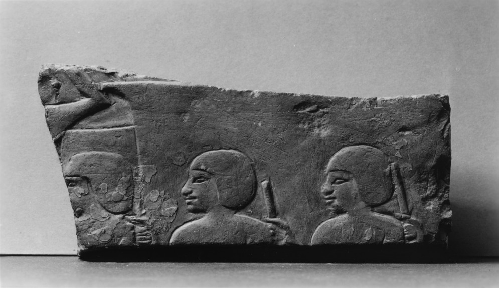 Wall Fragment with Enslaved Men Holding Staffs