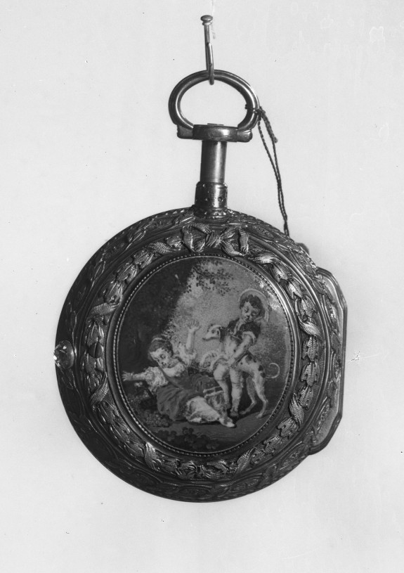 Watch with oval medallion of a boy and girl playing with a dog