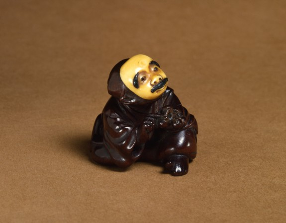 Netsuke of a Man Wearing a Mustached Mask