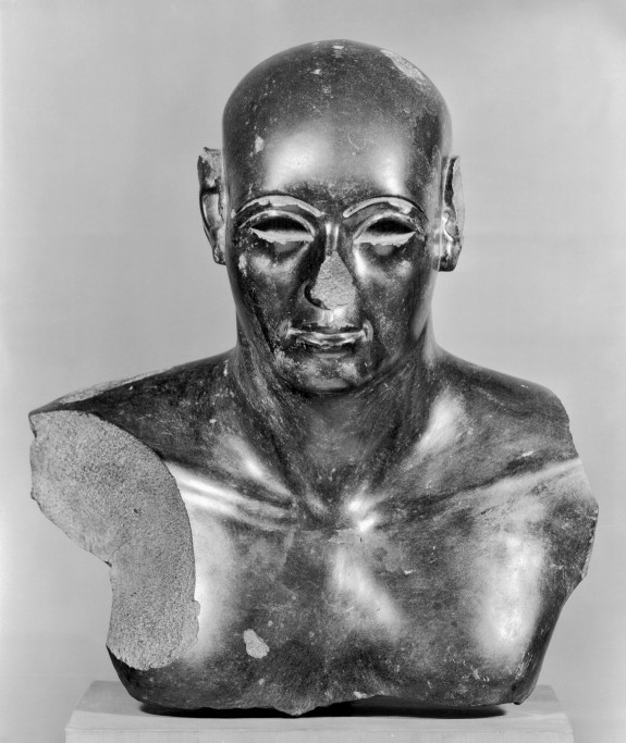 Upper Part of a Statue of a Man