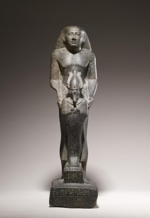 Priest Holding the Figure of Osiris