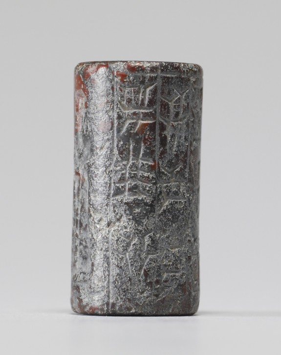 Cylinder Seal with a Standing Worshipper and Inscription