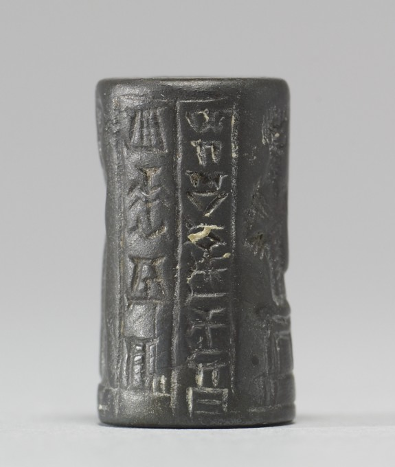 Cylinder Seal with a Seated Deity, Figures and Inscription