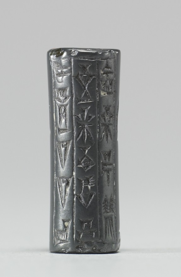Cylinder Seal with Standing Figures and Inscription