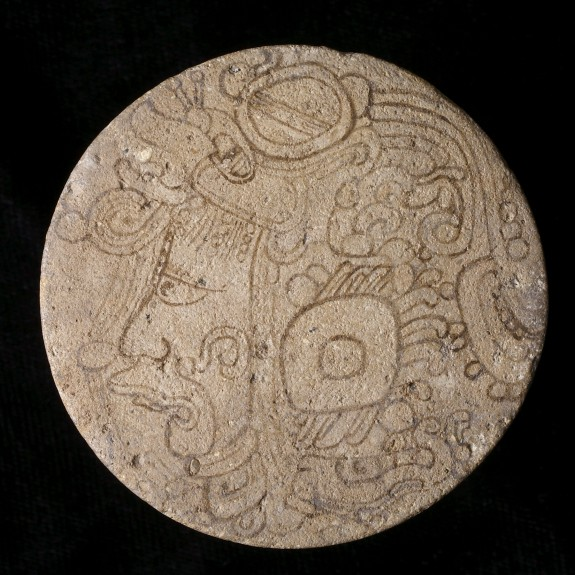 One of a Pair of Maya Painted Earflares with Profile Deity Heads