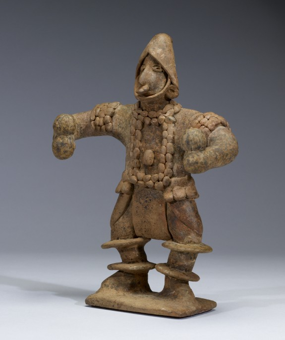 Standing Figure with Elaborate Costume Holding Rattles