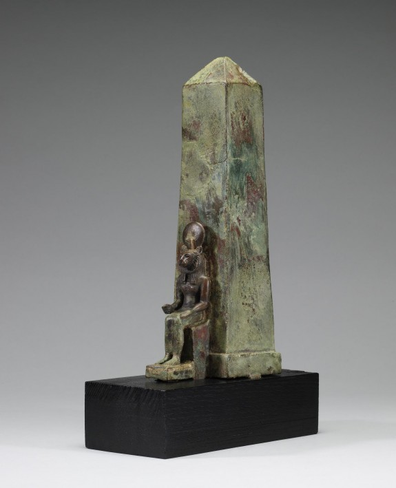 Figure of a Lion-Headed Goddess in Front of an Obelisk
