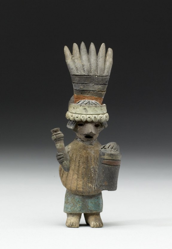 Female Performer Holding Drum and Striker or Rattle