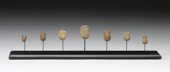 Human Head and Animal Effigy Beads