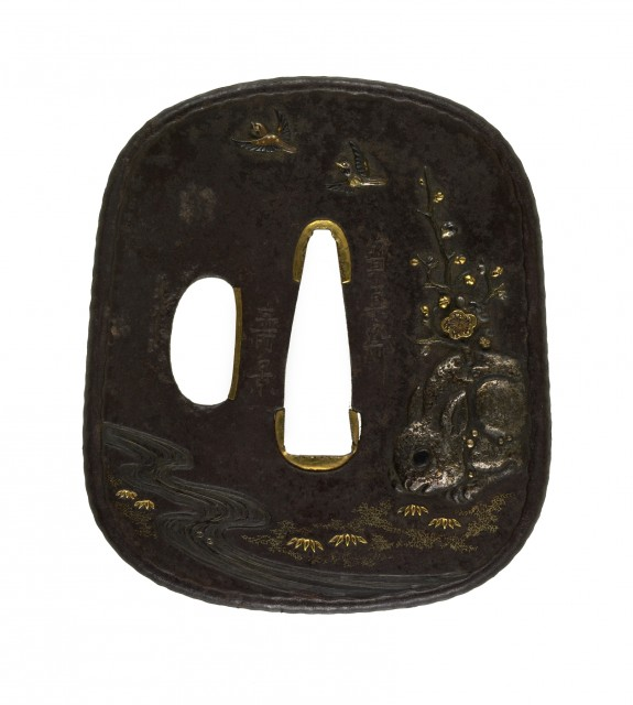 Tsuba with Stone Rabbit with a Blossoming Plum Branch