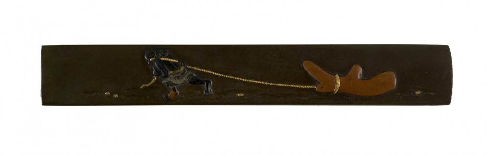 Kozuka with a Man Pulling a Piece of Coral