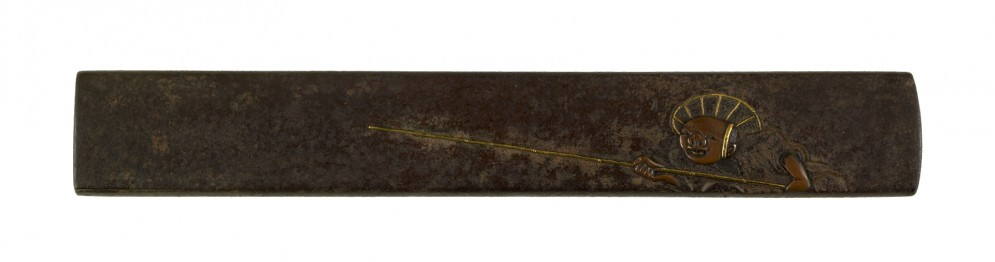 Kozuka with a Man Holding a Blow Pipe