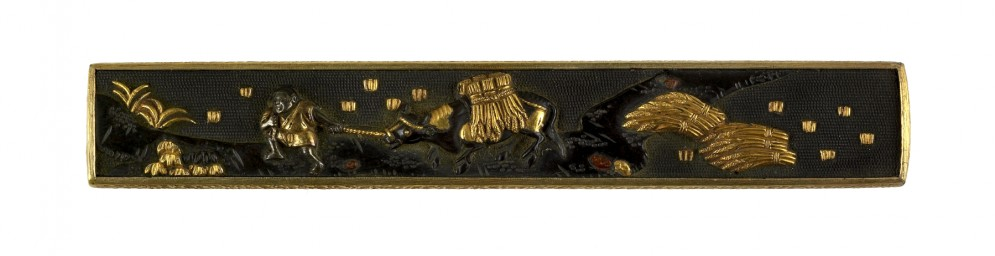 Kozuka with A Man Leading an Ox with Sheaves of Rice