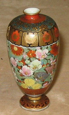 Vase with Elaborate Flowers and Geometric Designs
