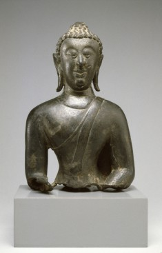 "Head and Upper Body of a Seated Buddha in ""Maravijaya"""
