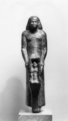 Man Holding a Shrine Containing a Figure of Osiris