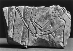 Relief Fragment with a Squatting Male Figure and Two Female Figures