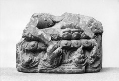 Lower Part of a Seated Figure on a Double Lotus Throne