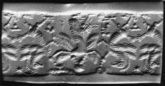 Cylinder Seal with Winged Deity with Mythical Bird