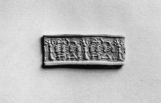 Cylinder Seal with a Standing Figure and Animals