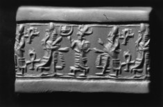 Cylinder Seal with Figures, an Ankh (?) and Symbols