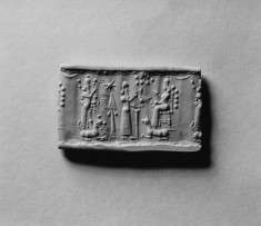 Cylinder Seal with God Assur (?) and a Seated Goddess