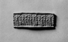 Cylinder Seal with Figures, Winged Genius, Animals and Rosette