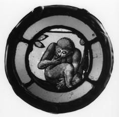 Roundel with Monkey Eating Fruit
