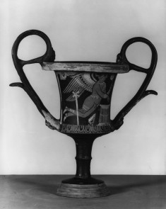 Drinking Vessel with Winged Eros and Seated Woman