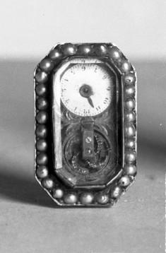Watch set in face of a brooch