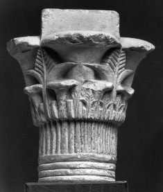 Model of a Composite Capital with Grid on the Top