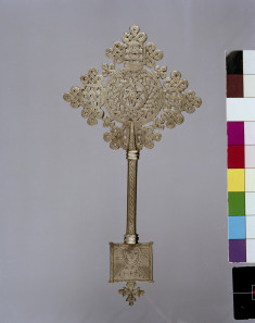 Ethiopian Hand Cross Decorated with the Face of a Saint and Strapwork