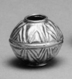 Spherical w/ triangular decoration
