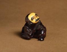 Netsuke of a Man Wearing a Mustached Mask