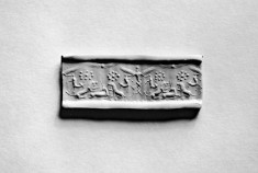 Cylinder Seal with a Winged Genius and Animals