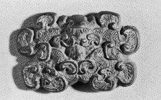 One of a Pair of Buckle Heads