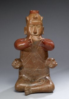 Seated Male with Trophy Heads