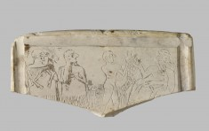 Relief Fragment with Male Figures Carrying Goats Before a Ruler
