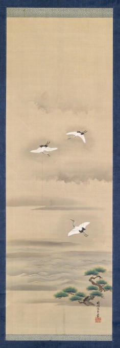 Three Cranes Flying in a Misty Landscape