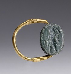 Scarab with Herakles Holding a Club and a Bow Set in a Swivel Ring