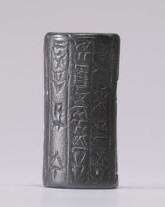 Cylinder Seal with Standing Figures and an Inscription