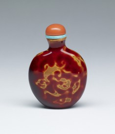 Snuff Bottle with Dragon-like Forms, in Imitation of Carnelian
