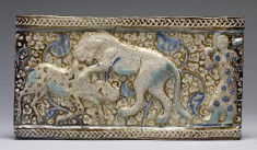 Fritware Tile with a Lion Attacking a Zebu