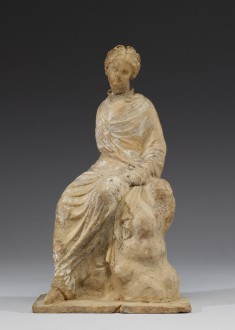 "Seated Maiden with ""Melon"" Hairstyle"