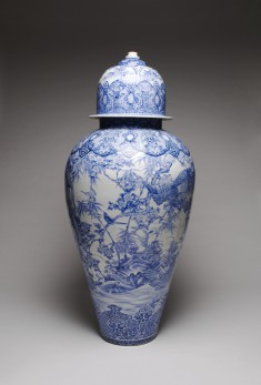 Arita Ware Covered Jar with a Panel Depicting a Collection of Antiques in a Chinese Garden