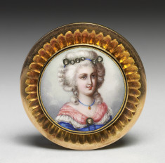 Brooch with image of a woman on porcelain