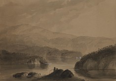 View of Men Fishing from a Rock in a Lake