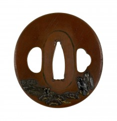 Tsuba with a Crow and a Heron on a Pine Branch in Rain