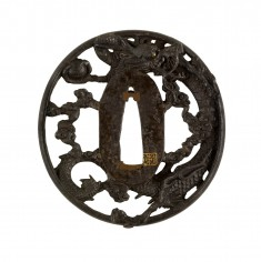 Tsuba with a Dragon Holding a Pearl